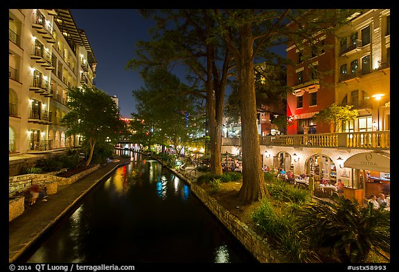 Residences and restaurants, Riverwalk at night. San Antonio, Texas, USA (color)