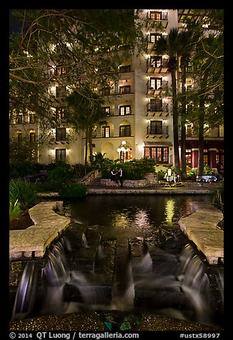 Waterfall, elegant couple in distance. San Antonio, Texas, USA (color)