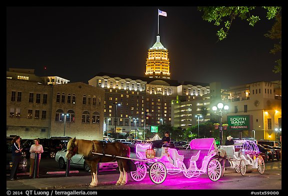 Horse carriages and Tower Life Building at night. San Antonio, Texas, USA (color)