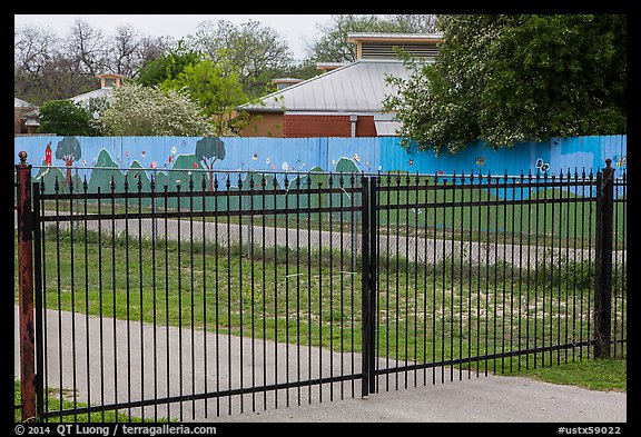 Fence with landscape mural decor. San Antonio, Texas, USA (color)