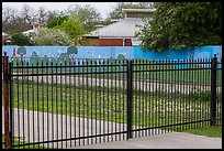 Fence with landscape mural decor. San Antonio, Texas, USA