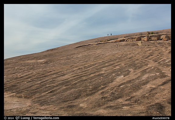 Granite dome with hikers, Enchanted Rock. Texas, USA (color)