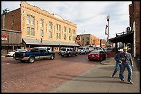 Stokyards street with brick buildings, men with cowboy hats. Fort Worth, Texas, USA ( color)