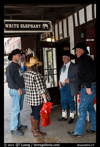 Group in front of White Elephant bar. Fort Worth, Texas, USA (color)
