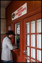 Man registers as rodeo contestant, Stockyards. Fort Worth, Texas, USA ( color)