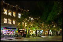 Street at night with lighted stores. Fort Worth, Texas, USA ( color)