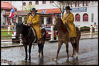 Cowboys in raincoats. Fort Worth, Texas, USA ( color)