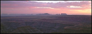 Sunset over canyon and distant mesas. Monument Valley Tribal Park, Navajo Nation, Arizona and Utah, USA (Panoramic color)