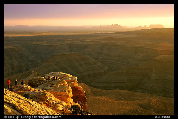 Watching the sunset over the San Juan River, Monument Valley in the background. Utah, USA