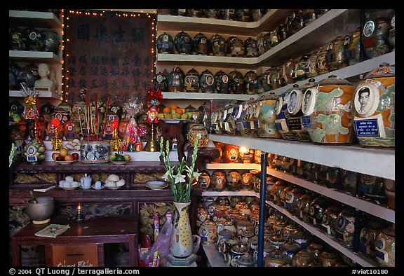 Temple room containing funeral urns with ashes of the deceased. Ho Chi Minh City, Vietnam (color)