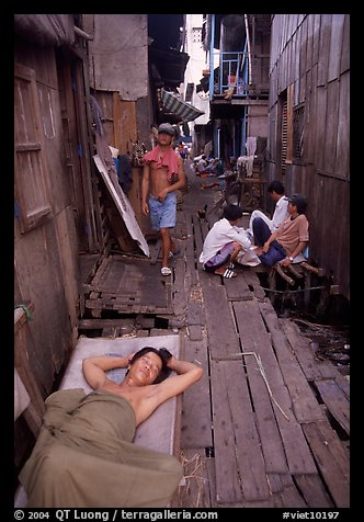 Sleeping late in a narrow alley. Ho Chi Minh City, Vietnam (color)