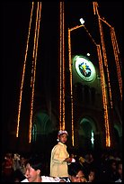 Child with christmas hat in front of St Joseph Cathedral on Christmas eve. Ho Chi Minh City, Vietnam ( color)