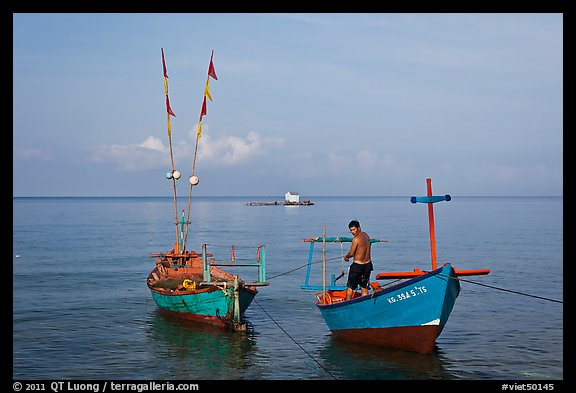 Fisherman on skiff. Phu Quoc Island, Vietnam (color)