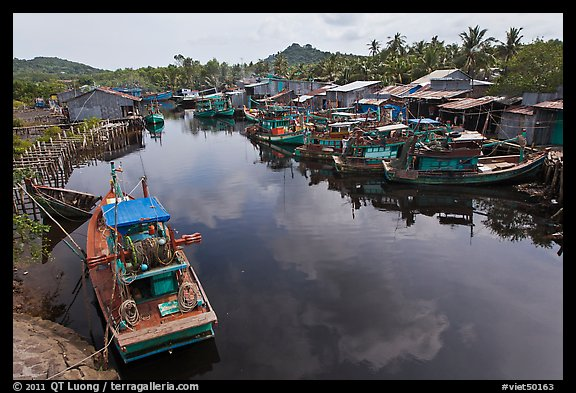 Fishing boats along dark river. Phu Quoc Island, Vietnam (color)