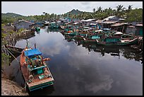 Fishing boats along dark river. Phu Quoc Island, Vietnam ( color)