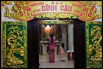 Woman with girl worshipping at Dinh Cau temple, Duong Dong. Phu Quoc Island, Vietnam