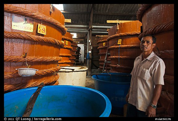 Worker in fish sauch factory, Duong Dong. Phu Quoc Island, Vietnam (color)