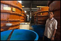 Worker in fish sauch factory, Duong Dong. Phu Quoc Island, Vietnam ( color)