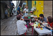 Breakfast at food stall in alley. Ho Chi Minh City, Vietnam (color)
