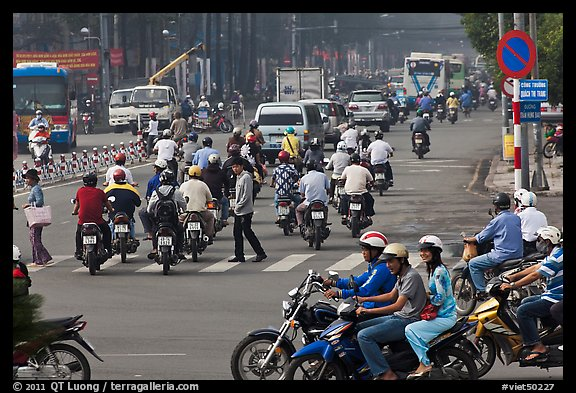 Motorcyle traffic on large avenue. Ho Chi Minh City, Vietnam (color)