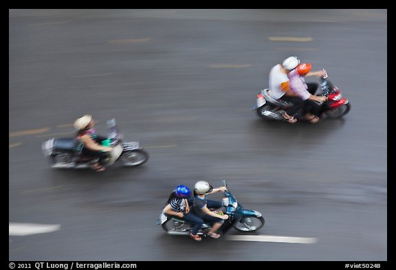 Motorbike riders seen from above with speed blur. Ho Chi Minh City, Vietnam (color)