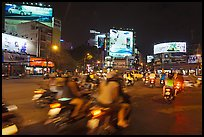 Moving traffic at night on traffic circle. Ho Chi Minh City, Vietnam (color)