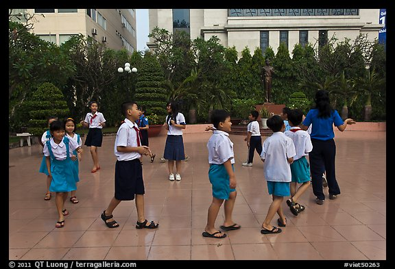 Children walking in circle in park. Ho Chi Minh City, Vietnam (color)