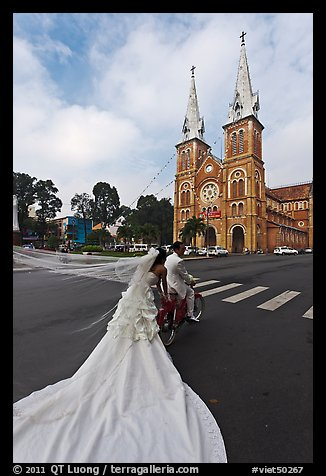 Bride with flowing dress in front of Cathedral. Ho Chi Minh City, Vietnam (color)