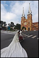 Bride with flowing dress in front of Cathedral. Ho Chi Minh City, Vietnam ( color)