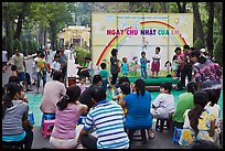 Children singing, Cong Vien Van Hoa Park. Ho Chi Minh City, Vietnam (color)