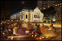 Motorbikes and colonial-area Opera House at night. Ho Chi Minh City, Vietnam (color)