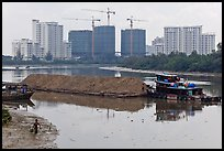 River scene and high rise towers in construction, Phu My Hung, district 7. Ho Chi Minh City, Vietnam ( color)