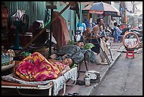 Vendors sleeping on the street at dawn. Ho Chi Minh City, Vietnam