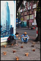 Men having breakfast on a sidewalk. Ho Chi Minh City, Vietnam