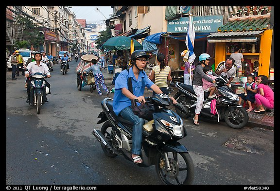 Early morning street scene. Ho Chi Minh City, Vietnam (color)