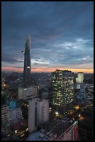 Bitexco Tower and city lights at sunset. Ho Chi Minh City, Vietnam (color)