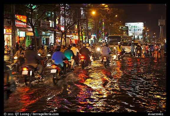 Picture/Photo: Flooded street and light reflections  Ho Chi