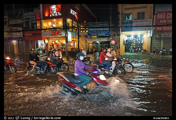 Street flooded by mooson rains at night. Ho Chi Minh City, Vietnam (color)