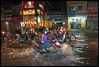 Street flooded by mooson rains at night. Ho Chi Minh City, Vietnam