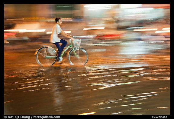 Night Bicyclist, water, and motion light streaks. Ho Chi Minh City, Vietnam (color)