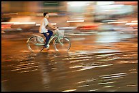 Night Bicyclist, water, and motion light streaks. Ho Chi Minh City, Vietnam ( color)