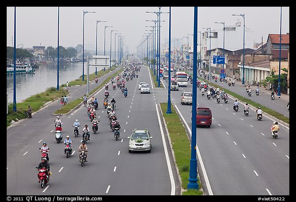 Busy expressway on banks of Saigon Arroyau. Cholon, Ho Chi Minh City, Vietnam (color)