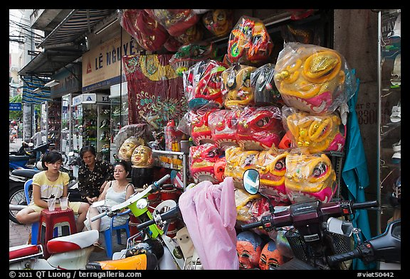 Shop selling dragon heads used for traditional dancing. Cholon, Ho Chi Minh City, Vietnam (color)
