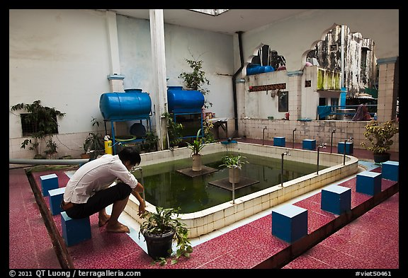 Man sitting in mosque pool, Cholon Mosque. Cholon, District 5, Ho Chi Minh City, Vietnam (color)