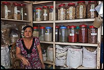 Woman with jars of traditional medicinal supplies. Cholon, Ho Chi Minh City, Vietnam (color)