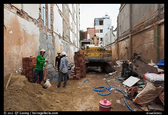 Buiding in construction in narrow space. Ho Chi Minh City, Vietnam (color)