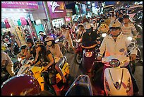 Street filled with motorcycles at rush hour. Ho Chi Minh City, Vietnam (color)