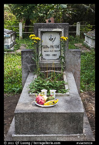 Tomb with fruit and refreshments offering. Ben Tre, Vietnam (color)