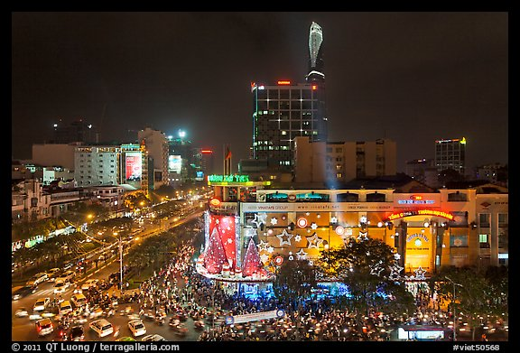 Cityscape with dense rush hour traffic at the intersection of two main boulevards. Ho Chi Minh City, Vietnam (color)