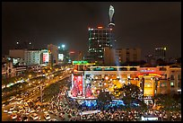 Cityscape with dense rush hour traffic at the intersection of two main boulevards. Ho Chi Minh City, Vietnam ( color)